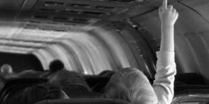 child pushing button on aeroplane