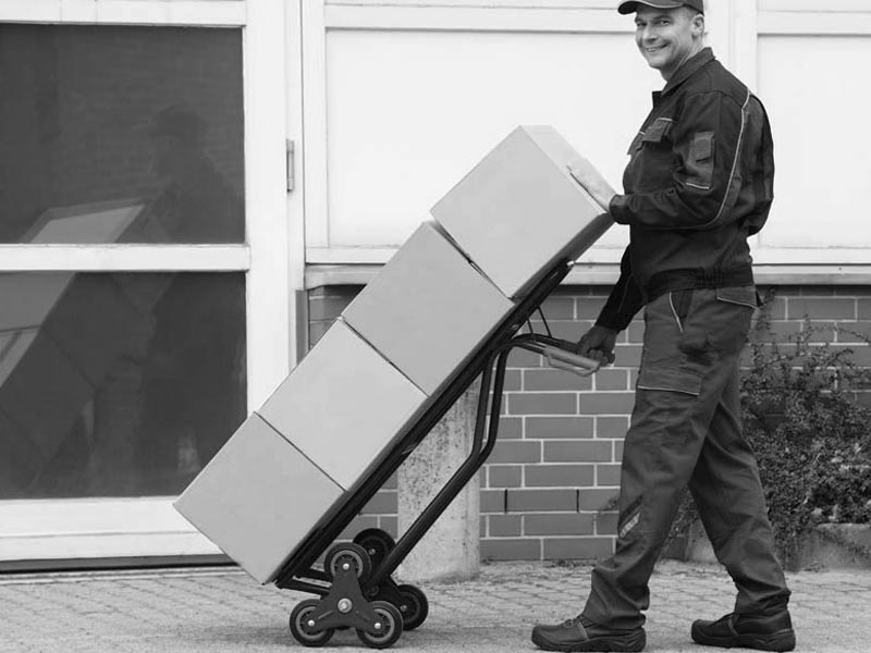 Courier using sack truck to deliver boxes