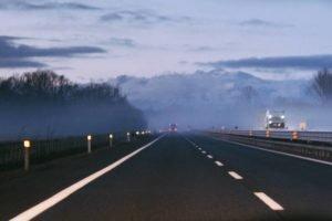 Courier driving on empty motorway during coronavirus lockdown